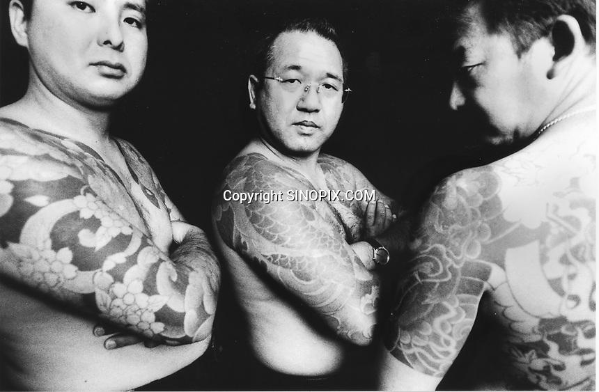 Former Yakuza (Japanese gangstars) turned into missionaries show their tatoos.<br /> KAZUCHOMI,SHINADA,KAZUCHOMI SHINADA,SOUICHI