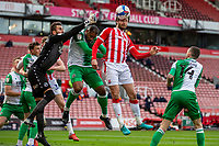 5th April 2021; Bet365 Stadium, Stoke, Staffordshire, England; English Football League Championship Football, Stoke City versus Millwall; Nick Powell of Stoke City heads the ball from a corner kick