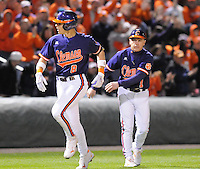 First baseman Richie Shaffer (8) of the Clemson Tigers is congratulated after hitting a solo home run in the fourth inning of a game against the South Carolina Gamecocks on Tuesday, March 8, 2011, at Fluor Field in Greenville, S.C.  South Carolina won, 5-4.  Photo by Tom Priddy / Four Seam Images.