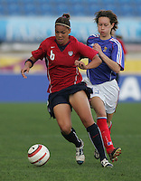 MAR 13, 2006: Faro, Portugal:  USWNT forward (6) Natasha Kai looks to pass while playing  France in the Algarve Cup in Faro Portugal.