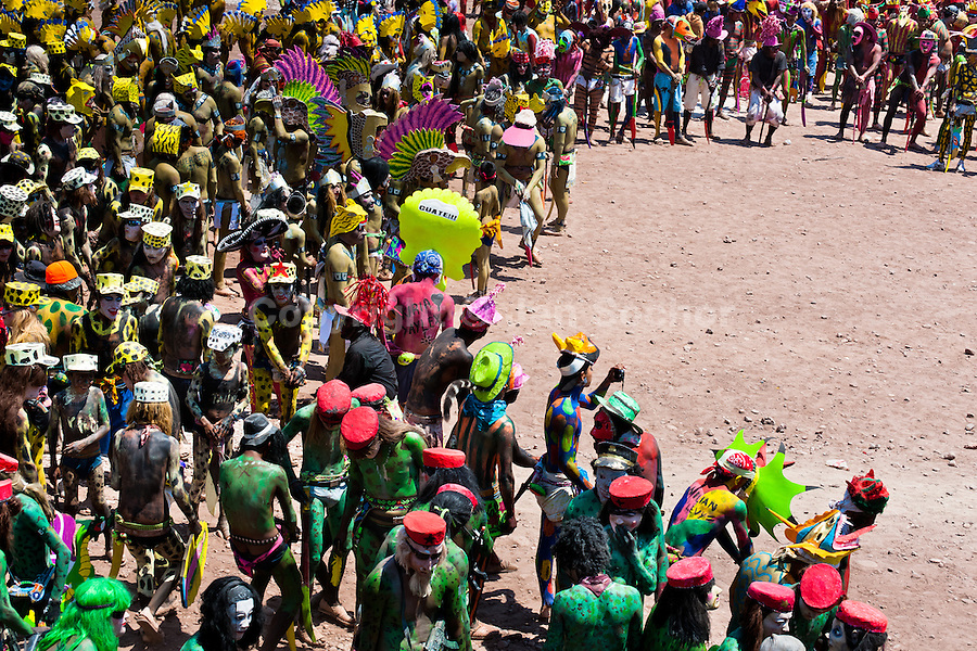 """Cora Indians, wearing colorful demon masks, take a part in a procession during the sacred ritual celebration of Semana Santa (Holy Week) in Jesús María, Nayarit, Mexico, 22 April 2011. The annual week-long Easter festivity (called """"La Judea""""), performed in the rugged mountain country of Sierra del Nayar, merges indigenous tradition (agricultural cycle and the regeneration of life worshipping) and animistic beliefs with the Christian dogma. Each year in the spring, the Cora villages are taken over by hundreds of wildly running men. Painted all over their semi-naked bodies, fighting ritual battles with wooden swords and dancing crazily, they perform demons (the evil) that metaphorically chase Jesus Christ, kill him, but finally fail due to his resurrection. La Judea, the Holy Week sacred spectacle, represents the most truthful expression of the Coras' culture, religiosity and identity."""