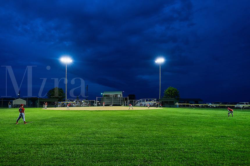 Little League baseball game at night, Delaware, USA