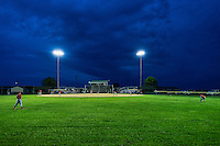 Little League baseball game at night, Delaware, USA