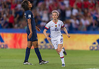 PARIS,  - JUNE 28: Wendie Renard #3 reacts to a goal by Megan Rapinoe #15 during a game between France and USWNT at Parc des Princes on June 28, 2019 in Paris, France.