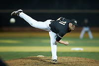 Wake Forest Demon Deacons relief pitcher Shane Muntz (11) delivers a pitch to the plate against the Notre Dame Fighting Irish at David F. Couch Ballpark on March 10, 2019 in  Winston-Salem, North Carolina. The Fighting Irish defeated the Demon Deacons 8-7 in 10 innings in game two of a double-header. (Brian Westerholt/Four Seam Images)