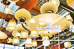 Multiple exposure image of residential lighting fixtures at salavage yard.