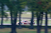 The #60 Foed Riley of Oswaldo Negri and John Pew races past some strees during the Grand-Am Rolex Series test at Virginia International Raceway, Alton, VA , October 2010. (Photo by Brian Cleary/www.bcpix.com)
