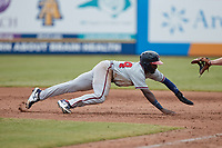 Michael Harris II (24) of the Rome Braves dives back towards first base during the game against the Greensboro Grasshoppers at First National Bank Field on May 16, 2021 in Greensboro, North Carolina. (Brian Westerholt/Four Seam Images)