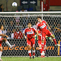 Chicago Fire fans midfielder John Thorrington (11) heads a ball away.  Chicago Fire defeated Toronto FC by the score of 2-1 at Toyota Park stadium, in Bridgeview, Illinois on Saturday, July 12, 2008.
