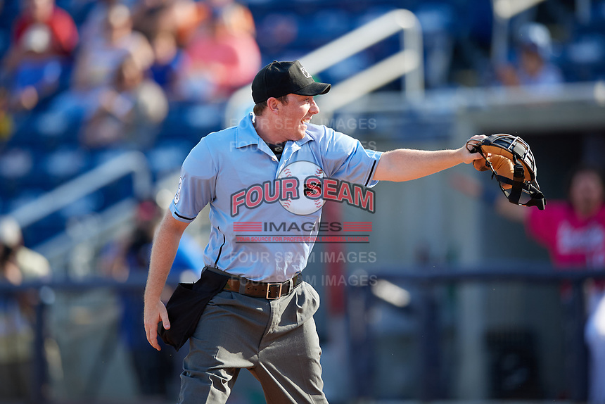 Umpire Tyler Jones calls a runner out at home during a Southern League game between the Mobile BayBears and Pensacola Blue Wahoos on July 25, 2019 at Blue Wahoos Stadium in Pensacola, Florida.  Pensacola defeated Mobile 2-1 in the first game of a doubleheader.  (Mike Janes/Four Seam Images)