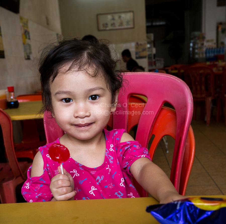 Young Malaysian Girl with Lolipop. Ipoh, Malaysia.