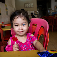 Young Malaysian Girl with Lolipop. Ipoh, Malaysia.