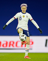 LE HAVRE, FRANCE - APRIL 13: Megan Rapinoe #15 of the United States traps the ball during a game between France and USWNT at Stade Oceane on April 13, 2021 in Le Havre, France.