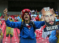 A USA fan holds a cardboard cut out of goalkeeper Tim Howard with the message 'We Believe'