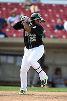 Kane County Cougars outfielder Yasiel Balaguert (22) at bat during a game against the Quad Cities River Bandits on August 20, 2014 at Third Bank Ballpark in Geneva, Illinois.  Kane County defeated Burlington 7-3.  (Mike Janes/Four Seam Images)