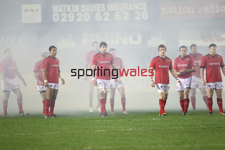 The Munster players emerge from the smoke created by fireworks before kick off..Celtic League.Cardiff Blues v Munster.02.11.12.©Steve Pope