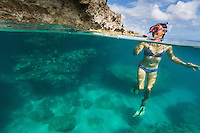 A woman pauses to tread water while snorkeling at Shark's Cove on the North Shore of O'ahu.