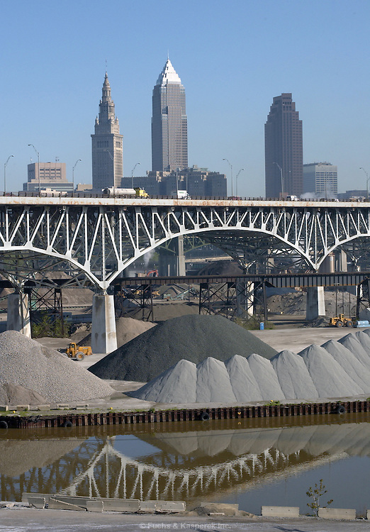 """The city of Cleveland seen from the south.The area in the foreground is referred to as """"The Flats"""". It is an area that has historically been filled with heavy industry. in recent years, entertainment facilities have been moving in alongside the industry."""