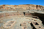 """Chaco Canyon was a major center of Puebloan culture between AD 850 and 1250. The Chacoan sites are part of the homeland of Pueblo Indian peoples of New Mexico, the Hopi Indians of Arizona, and the Navajo Indians of the Southwest. Chaco Culture National Historical Park is a United States National Historical Park and a UNESCO World Heritage Site hosting the densest and most exceptional concentration of pueblos in the American Southwest. The park is located in northwestern New Mexico, between Albuquerque and Farmington, in a relatively inaccessible canyon cut by the Chaco Wash. Containing the most sweeping collection of ancient ruins north of Mexico, the park preserves one of America's most fascinating cultural and historic areas.[1]..Between AD 900 and 1150, Chaco Canyon was a major center of culture for the Ancient Pueblo Peoples.?[?] Chacoans quarried sandstone blocks and hauled timber from great distances, assembling fifteen major complexes which remained the largest buildings in North America until the 19th century.[1][2] Evidence of archaeoastronomy at Chaco has been proposed, with the """"Sun Dagger"""" petroglyph at Fajada Butte a popular example. Many Chacoan buildings may have been aligned to capture the solar and lunar cycles,[3] requiring generations of astronomical observations and centuries of skillfully coordinated construction.[4] Climate change is thought to have led to the emigration of Chacoans and the eventual abandonment of the canyon, beginning with a 50-year drought in 1130.[5]..Located in the arid and inhospitable Four Corners region, the Chacoan cultural sites are fragile; fears of erosion caused by tourists have led to the closure of Fajada Butte to the public. The sites are considered sacred ancestral homelands of the Hopi and Pueblo people, who continue to maintain oral traditions recounting their historical migration from Chaco and their spiritual relationship to the land.[6][7] Though park preservation efforts can conflict with native religious"""