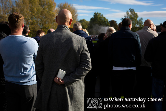 Spectators watching the action during the second-half at the UTS Stadium during the FA Cup fourth qualifying round match between Dunston UTS (in blue) and their local rivals Gateshead. Founded in 1975, the home team were formerly known as Dunston Federation. The visitors won 4-0 watched by a record crowd of 2,500.