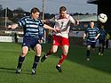 Forfar's Darren Dods and Stranraer's Craig Malcolm challenge for the ball.