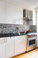 White modern kitchen with mosaic decor