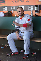 SAN FRANCISCO, CA - AUGUST 21:  Shane Victorino #18 of the Boston Red Sox gets ready for his next at bat in the dugout against the San Francisco Giants during the game at AT&T Park on Wednesday, August 21, 2013 in San Francisco, California. Photo by Brad Mangin