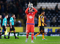 Swansea City goalkeeper Kristoffer Nordfeldt thanks the fans at the end of the game during the Capital One Cup match between Hull City and Swansea City played at the Kingston Communications Stadium, Hull