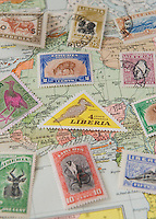 Vintage Postage Stamps from the African Country of Liberia against a 1930 Map of the African Continent.