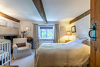 BNPS.co.uk (01202 558833)<br /> Pic: Strutt&Parker/BNPS<br /> <br /> Pictured: Bedroom. <br /> <br /> An 18th century cottage in 'the prettiest village in England' is on the market for £675,000.<br /> <br /> Number 2 School Lane is Grade II listed, built with beautiful Cotswold stone and filled with character features like exposed timber beams and original fireplaces.<br /> <br /> The attractive three-bedroom property is in the highly sought after Wiltshire village of Castle Combe.<br /> <br /> The quintessentially English village has been used regularly as a film location and the houses are mostly made with honey-coloured Cotswold stone.