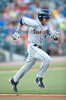 Diego Castillo (7) of the Charleston RiverDogs hustles down the first base line against the Columbia Fireflies at Spirit Communications Park on June 9, 2017 in Columbia, South Carolina.  The Fireflies defeated the RiverDogs 3-1.  (Brian Westerholt/Four Seam Images)
