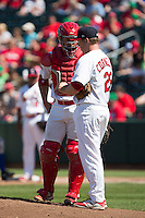 Travis Tartamella (4) of the Springfield Cardinals talks with Jonathan Cornelius (29) of the Springfield Cardinals during a game against the Tulsa Drillers at Hammons Field on May 4, 2014 in Springfield, Missouri. (David Welker/Four Seam Images)