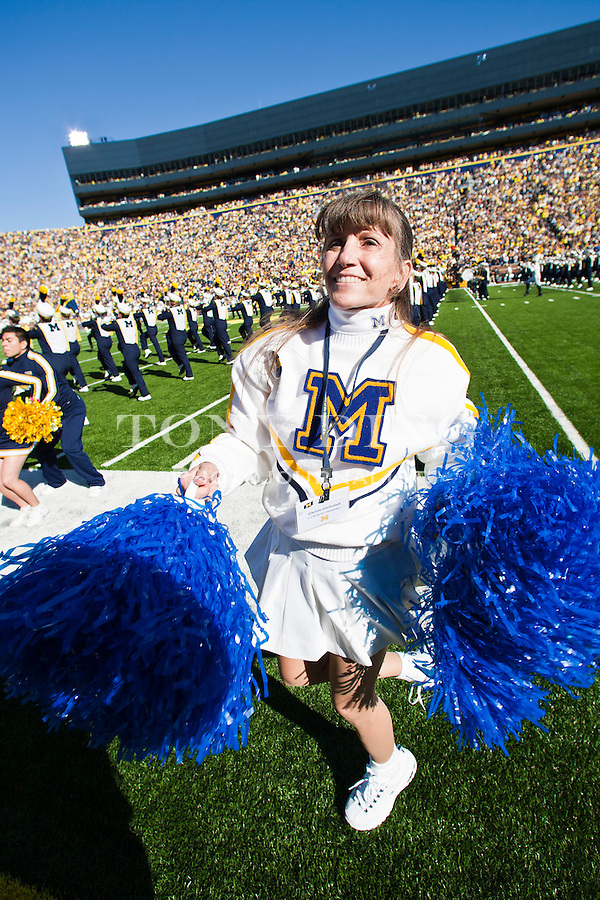 Michigan alumni cheerleader Glenda Gerbstadt performs on the sideline before an NCAA college football game Iowa, Saturday, Oct. 16, 2010, in Ann Arbor, Mich. (AP Photo/Tony Ding)