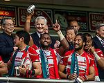 Japan players celebrate with the trophy after winning the Qualifier Final during the Cathay Pacific / HSBC Hong Kong Sevens at the Hong Kong Stadium on 30 March 2014 in Hong Kong, China. Photo by Andy Jones / Power Sport Images