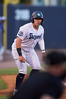 Tampa Tarpons third baseman Andres Chaparro (24) leads off third base during a game against the Dunedin Blue Jays on May 7, 2021 at George M. Steinbrenner Field in Tampa, Florida.  (Mike Janes/Four Seam Images)