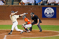 Mac Williamson #7 of the Wake Forest Demon Deacons follows through on his swing against the Miami Hurricanes during Game Nine of the 2012 ACC Baseball Championship at NewBridge Bank Park on May 25, 2012 in Winston-Salem, North Carolina.  The Hurricanes defeated the Demon Deacons 6-3.  (Brian Westerholt/Four Seam Images)