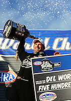 Nov. 13, 2011; Pomona, CA, USA; NHRA top fuel dragster driver Del Worsham celebrates after clinching the 2011 world championship at the Auto Club Finals at Auto Club Raceway at Pomona. Mandatory Credit: Mark J. Rebilas-.