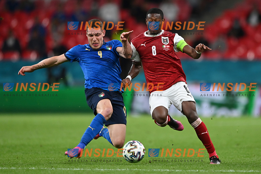 LONDON, ENGLAND - JUNE 26: David Alaba of Austria is challenged by Andrea Belotti of Italy during the UEFA Euro 2020 Championship Round of 16 match between Italy and Austria at Wembley Stadium at Wembley Stadium on June 26, 2021 in London, England. (Photo by Shaun Botterill - UEFA/UEFA via Getty Images)<br /> Photo Uefa/Insidefoto ITA ONLY