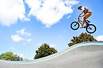 BOSTON June 12:  David Rothfuss of Boston takes to the sky as he gets some air with his BMX bike,  Sunday, June 12, 2020, at the Smith Park Pumptrack in Allston in Boston. (Jim Michaud / MediaNews Group/Boston Herald)