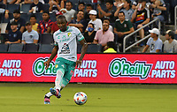 KANSAS CITY, KS - AUGUST 10: Andres Mosquera #4 of Club Leon FC passes the ball back to goal during a game between Club Leon FC and Sporting KC at Children's Mercy Park on August 10, 2021 in Kansas City, Kansas.