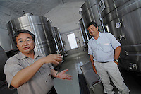Denis Dubourdieu and winery owner Mr Misawa at the Grace winery in Yamanashi Prefecture, Japan. Dubourdieu is helping to develop a Japanese white wine that will be eaten primarily with Japanese cuisine.