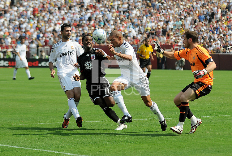 DC United forward Luciano Emilio (11) versus Real Madrid defenders Raul Albiol (18), Pepe (3) and goalkeeper Iker Casillas (1). Real Madrid defeated DC United 3-0 at FedEx Field, Sunday August 9, 2009 in an International Friendly.