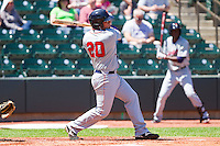 Adam Abraham #20 of the Kinston Indians follows through on his swing against the Winston-Salem Dash at BB&T Ballpark on April 17, 2011 in Winston-Salem, North Carolina.   Photo by Brian Westerholt / Four Seam Images