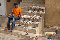 El Hadj Keita, Sculptor, and his Art Displayed inside the Fort d'Estrees, Biannual Arts Festival, Goree Island, Senegal.
