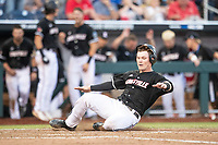 Louisville Cardinals catcher Henry Davis (32) slides home during Game 12 of the NCAA College World Series against the Vanderbilt Commodores on June 21, 2019 at TD Ameritrade Park in Omaha, Nebraska. Vanderbilt defeated Louisville 3-2. (Andrew Woolley/Four Seam Images)