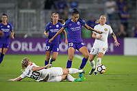 Orlando, FL - Saturday March 24, 2018: Orlando Pride defender Poliana Barbosa Medeiros (19) tries to avoid the slide tackle by Utah Royals forward Elise Thorsnes (20) during a regular season National Women's Soccer League (NWSL) match between the Orlando Pride and the Utah Royals FC at Orlando City Stadium. The game ended in a 1-1 draw.