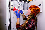 Mountain Lion (Puma concolor) biologist, Justine Alyssa Smith, placing blood samples into feezer, Santa Cruz Puma Project, UCSC Campus, Santa Cruz, Monterey Bay, California