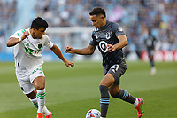 SAINT PAUL, MN - JUNE 23: Hassani Dotson #31 of Minnesota United FC and Nick Lima #24 of Austin FC battle for the ball during a game between Austin FC and Minnesota United FC at Allianz Field on June 23, 2021 in Saint Paul, Minnesota.