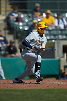 Kevin Brophy (13) of the West Virginia Mountaineers follows through on his swing against the Illinois Fighting Illini at TicketReturn.com Field at Pelicans Ballpark on February 23, 2020 in Myrtle Beach, South Carolina. The Fighting Illini defeated the Mountaineers 2-1.  (Brian Westerholt/Four Seam Images)