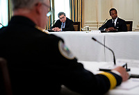 United States Attorney General William P. Barr and Attorney Daniel J, Cameron (Republican of Kentucky) look on as US President Donald Trump makes remarks as he participates in a roundtable with law enforcement officials in the State Dining Room of the White House in Washington, DC, Monday, June, 8, 2020.  <br /> Credit: Doug Mills / Pool via CNP/AdMedia
